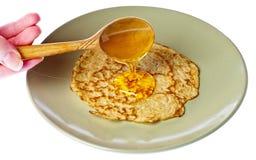 Pancakes with honey. Stock Photos