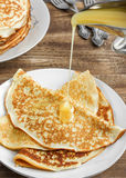 Pancakes with honey. On the white plate stock images