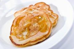 Pancakes with honey Royalty Free Stock Photos