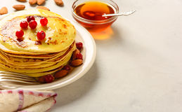 Pancakes with honey and almond Royalty Free Stock Photos