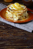 Pancakes with honey and bananas Royalty Free Stock Image