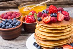 Pancakes with berries. Pancakes with honey berries : blueberries , raspberry and strawberry stock photography