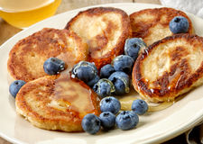 Pancakes with honey and blueberries royalty free stock photography