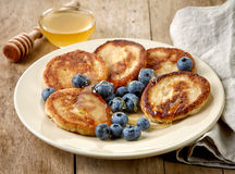 Pancakes with honey and blueberries stock photos