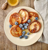 Pancakes with honey and blueberries royalty free stock images