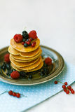 Pancakes with honey for breakfast. Pancakes with honey and berries for breakfast Stock Images