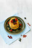 Pancakes with honey for breakfast Royalty Free Stock Photography