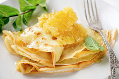 Pancakes with honey for breakfast. Close-up Royalty Free Stock Image