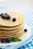 Pancakes with honey Royalty Free Stock Image