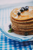Pancakes with honey Stock Images