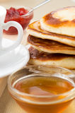 Pancakes with honey for breakfast Royalty Free Stock Photo