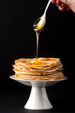 Pancakes with honey and butter Stock Images