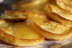 Pancakes with honey. Close-up Royalty Free Stock Image