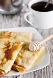 Pancakes with honey and coffee Royalty Free Stock Photography