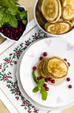 Pancakes with honey. And cranberries for breakfast on Valentine's Day Stock Images