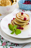 Pancakes with honey. And cranberries for breakfast on Valentine's Day Royalty Free Stock Photography