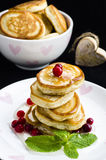 Pancakes with honey. And cranberries for breakfast on Valentine's Day Stock Photography