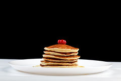 Pancakes with honey and cranberries Royalty Free Stock Photo