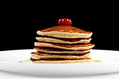 Pancakes with honey and cranberries Royalty Free Stock Images