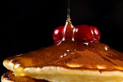 Pancakes with honey and cranberries Royalty Free Stock Photography