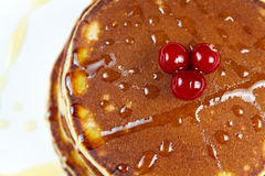 Pancakes with honey and cranberries Royalty Free Stock Image