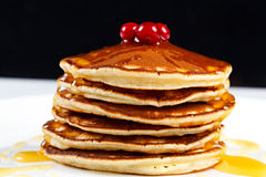 Pancakes with honey and cranberries Stock Images
