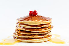 Pancakes with honey and cranberries Stock Photography