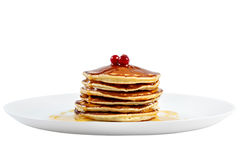 Pancakes with honey and cranberries on a plate. Stock Photo