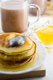 Pancakes with honey and a cup of hot cocoa Stock Photos