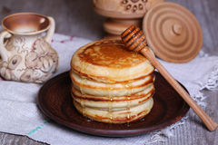 Pancakes with honey. On the desk Royalty Free Stock Images