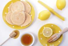 Pancakes, honey and lemons Stock Photo