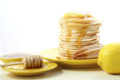 Pancakes, honey and lemons Royalty Free Stock Photos