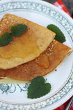 Pancakes with honey and mint Stock Photography