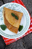 Pancakes with honey and mint Royalty Free Stock Image