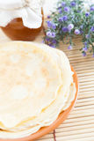 Pancakes with honey on a plate Royalty Free Stock Image