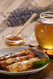 Pancakes with honey on a plate, the honey in a glass bowl on a l royalty free stock photos