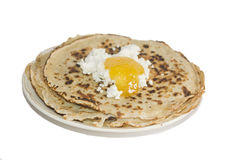 Pancakes and honey on the plate. Royalty Free Stock Image