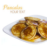 Pancakes with honey on square plate, isolated. Delicious breakfast Stock Photography