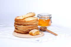 pancakes and honey Royalty Free Stock Image