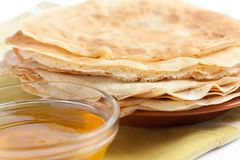 Pancakes and honey - a sweet dessert. Delicious meal Royalty Free Stock Image