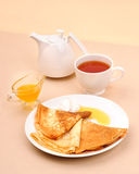 Pancakes with honey and tea Royalty Free Stock Photography