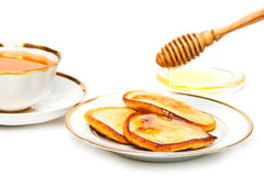 Pancakes with honey and tea Royalty Free Stock Photo