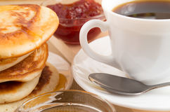 Pancakes with honey and white cup of coffee Stock Photo