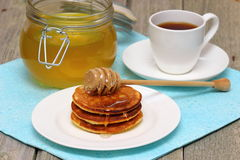 Pancakes. And honey on white dishware Shallow DOF stock images