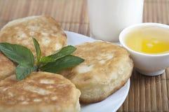 Pancakes with honey. And yogurt Stock Photos