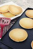 Pancakes on a Hot Griddle. Preparing fresh pancakes on a non-stick griddle Stock Photography