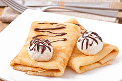 Pancakes with ice cream and chocolate sauce Stock Photos