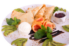 Pancakes and ice cream and fruits. On white Stock Photos