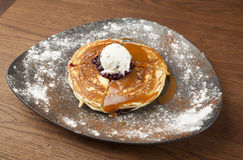 Pancakes with ice cream and topped with blueberries Royalty Free Stock Images