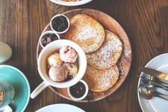 Pancakes with ice cream, vanilla icing sugar, brownies and Royalty Free Stock Photos